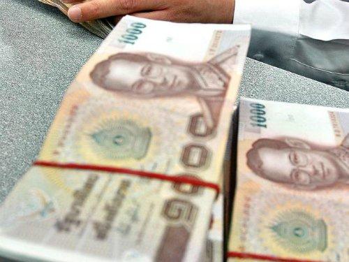 Giẫm lên tiền ở Thái Lan là một hành động bị xử phạt. Ảnh: News.
